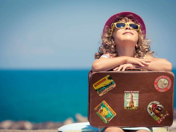 38259947 – child with vintage suitcase on summer vacation. travel and adventure concept
