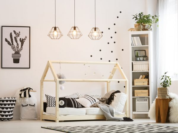 Eco friendly child bedroom with wood bed and modern lamps