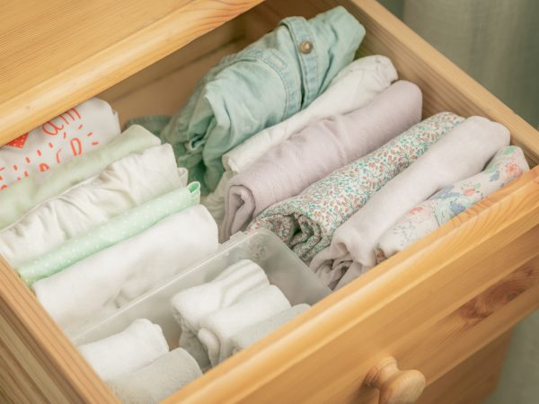 Marie Kondo tyding up method concept – folded clothes, copy space