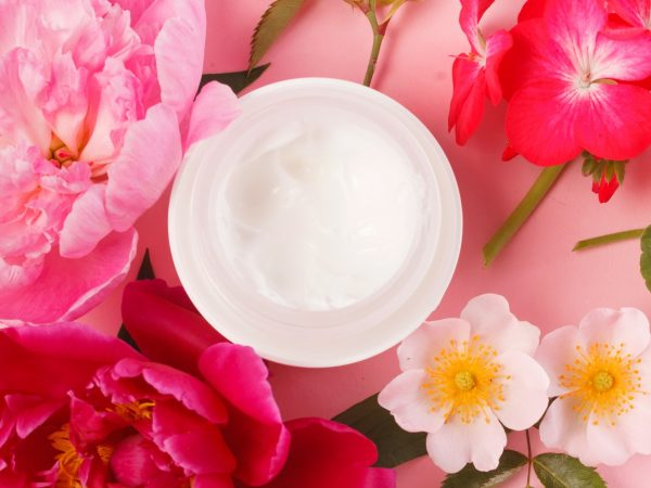cosmetic creams with pink flowers