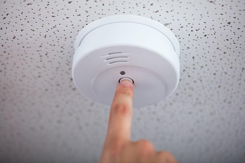 Human Finger Testing Smoke Detector