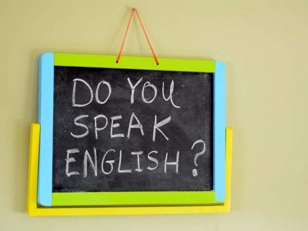 Do you speak english? Handwritten with white chalk on a blackboard.concept photo of learning and teaching English for travel, work and communication.